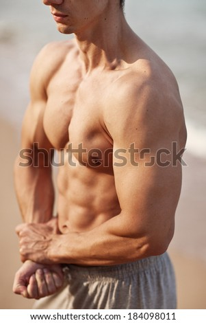 attractive man body on the beach