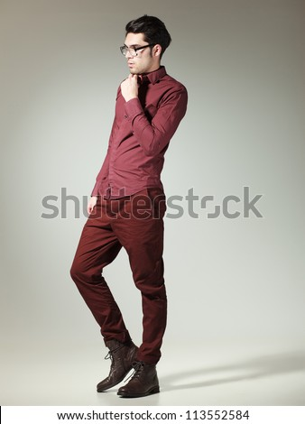 attractive man dressed casual-elegant posing in the studio (full body)