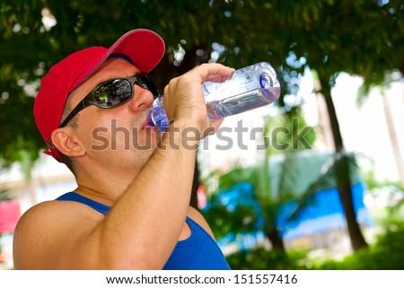 attractive man drink water outdoor