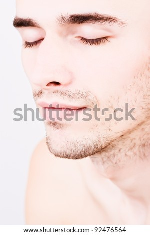attractive man face, eyes closed