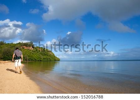 Attractive man in his fifties Hiking Kauai Beach
