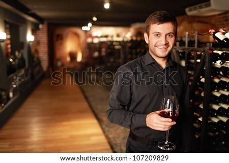Attractive man in the wine cellar