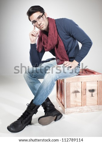 attractive man posing in the studio