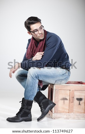 attractive man posing in the studio dressed casual wearing eye glasses