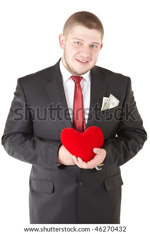 Attractive  man showing  heart in his hand. Isolated over white.