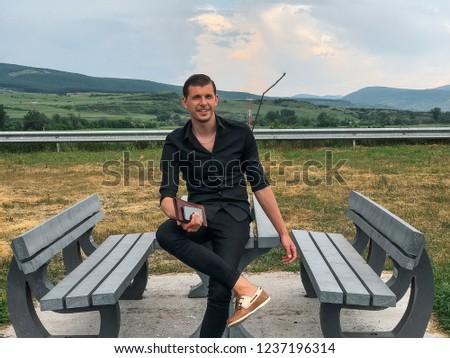 Attractive man using smartphone, stylish guy, black wear, hand watch, pretty, attractive, tan, man in sunglasses, black shirt, casual, fashion #1237196314