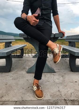 Attractive man using smartphone, stylish guy, black wear, hand watch, pretty, attractive, tan, man in sunglasses, black shirt, casual, fashion #1237196317