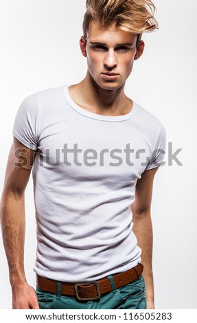 Attractive man wearing t-shirt - close up portrait on white background.