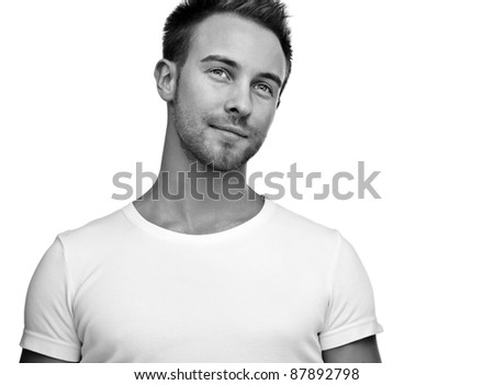 Attractive man wearing T-shirt close up portrait on white background. Black-white photo.