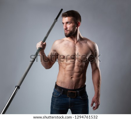 Attractive man with weights in his hands