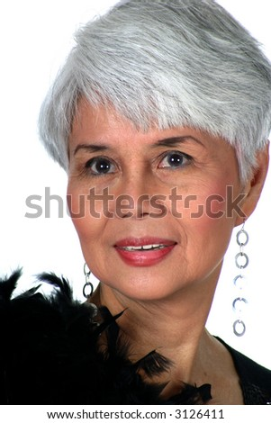 stock photo : Attractive mature woman dressed in black dress with feather ...