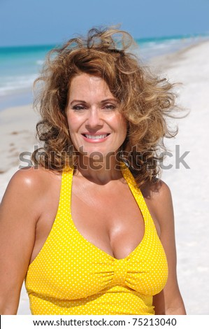 stock photo attractive mature woman in swimsuit enjoying the beach 75213040 Keep in mind that in the Studio Erotic PDF you can see more images of the ...