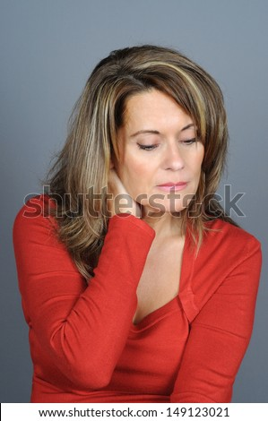 Attractive Mature Woman Rubbing Her Neck