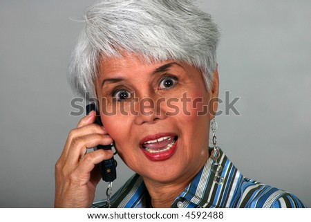 stock photo attractive mature woman talking on a cell phone 4592488 stock photo : Indian mature business man with mobile phone
