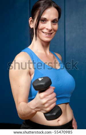 Attractive mature woman with free weight - stock photo