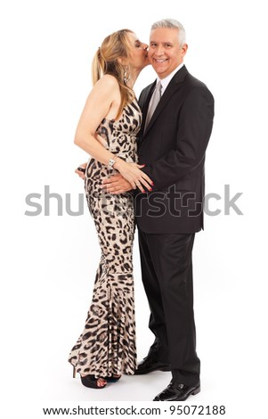 Attractive middle age couple in formal attire on a white background.