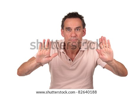 Attractive Middle Age Man Holding Up Hands to Signal Stop or Push Something Away