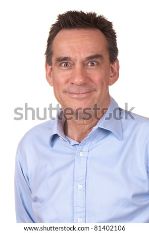 Attractive Middle Age Man in Blue Shirt with Silly Smile and Funny Expression