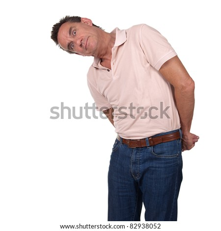 Attractive Middle Age Man Looking Sideways at Something with Surprised Quizzical Look and Hands Behind His Back