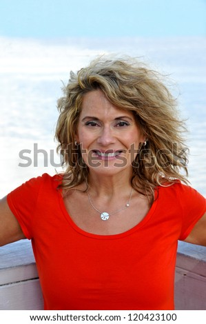 Attractive Middle Age Woman Wearing a Red Shirt