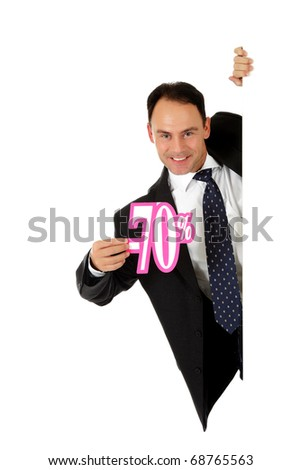 Attractive middle aged caucasian businessman behind a wall showing seventy percent discount sign. Copy space. Studio shot. White background.