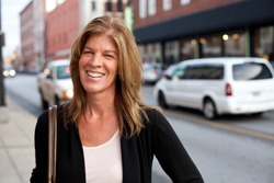 Attractive middle-aged woman downtown in the city.