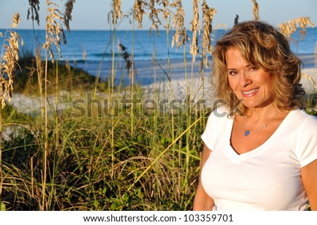 Attractive Middle Aged Woman on the Beach - stock photo