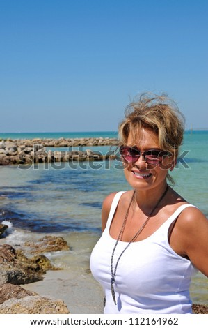 Attractive Middle Aged Woman Standing on Coastline
