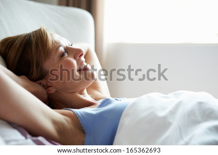 Attractive Middle Aged Woman Waking Up In Bed #165362693