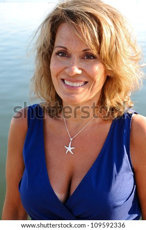 Attractive Middle Aged Woman Wearing A Blue Summer Dress