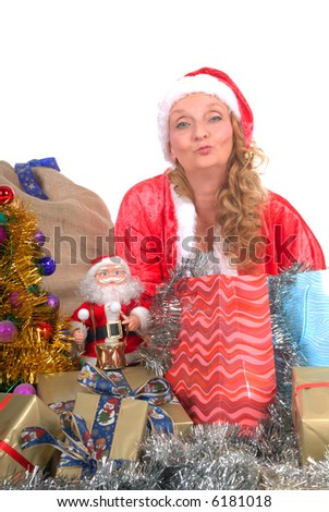 Attractive middle aged woman wearing in santa outfit surrounded with Xmas, Christmas presents. White background