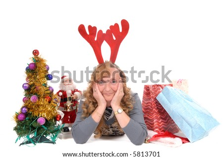 Attractive middle aged woman wearing reindeer antlers surrounded with Xmas, Christmas presents. White background - stock photo