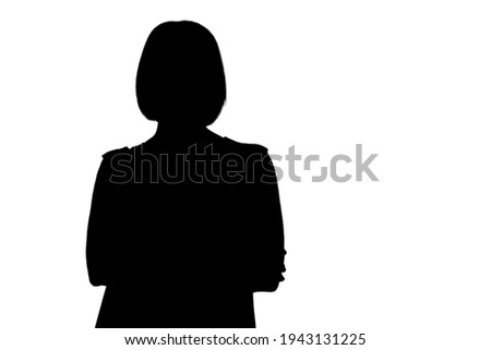 Attractive middle-aged woman with folded arms on gray background Foto stock ©
