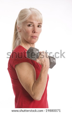 Attractive middle-aged woman working out isolated against white background