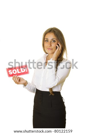 """Attractive modern business woman talking on the phone and keeps the card """"SOLD"""" in your other hand. isolated"""