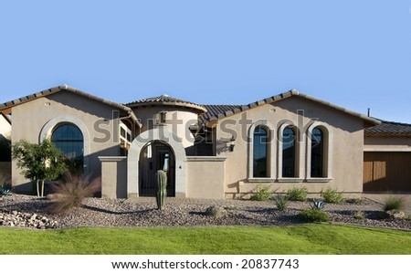 stock photo   attractive modern home exterior with blue sky copy space