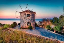 Attractive morning view of famous Korithi windmills. Early morning scene of Zakynthos island, Ionian Sea, Greece, Europe. Beauty of countryside concept background.