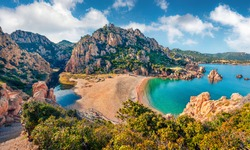 Attractive morning view of Li Cossi beach. Fantastic summer scene of Costa Paradiso, Sardinia island, Italy, Europe. Wonderful Mediterranean seascape. Beauty of nature concept background.