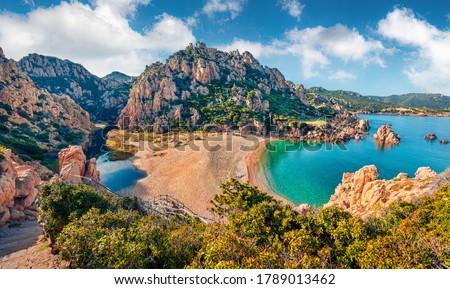 Attractive morning view of Li Cossi beach. Fantastic summer scene of Costa Paradiso, Sardinia island, Italy, Europe. Wonderful Mediterranean seascape. Beauty of nature concept background.