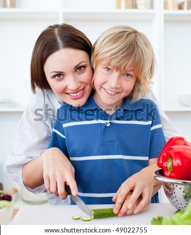 Attractive mother and her son cooking at home