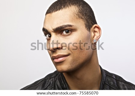 Attractive mulatto in a leather jacket on isolated studio background.