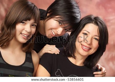 Attractive Multi ethnic Mother and Daughters Studio Portrait. - stock photo