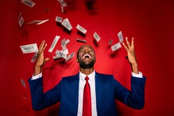 Attractive multiethnic man in style chic classy jacket blue formalwear  trendy tux tuxedo stand with closed eyes under money fly rain isolated on red vivid background raised hands up