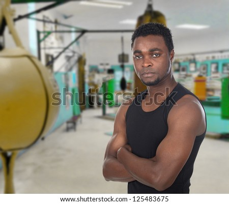 Attractive muscular man in a boxing gym