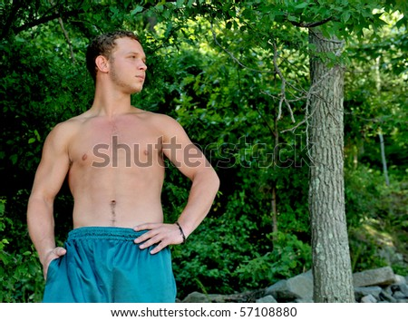 stock-photo-attractive-muscular-man-surrounded-by-trees-57108880.jpg