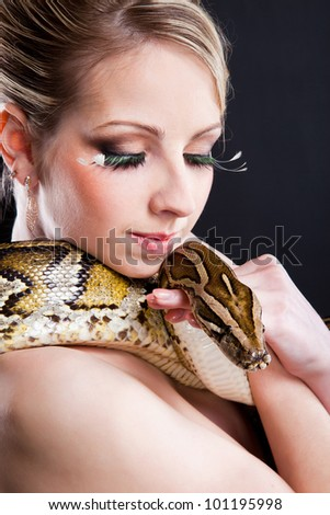 stock photo attractive nude blond woman with python on black background 101195998 Public Pee