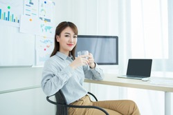 Attractive office worker resting in office