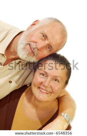Attractive older couple hugging and smiling; isolated on white