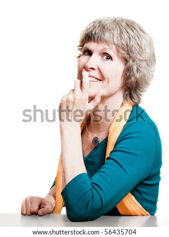 Attractive older woman smiling at the camera