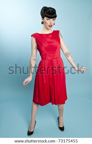 Attractive pinup model wearing red dress